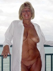 Sweet naked mature Ladies spreads legs