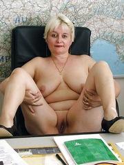 Russian business woman posing nude in..