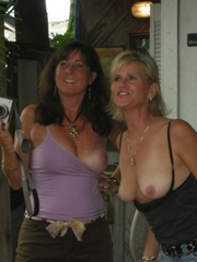Two mature bitches flashing tits in the..