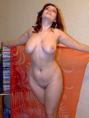 Curvy redhead MILF exposing her naked..