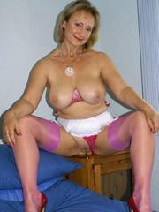 Playful mature woman posing naked