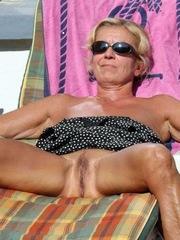 Slender granny sunbathing naked