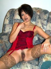 Skinny milf in a red silk corset and..